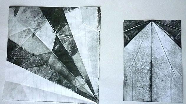 folded paper aeroplanes - art